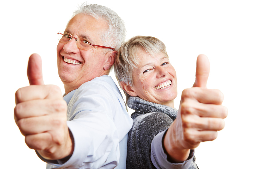 Happy elderly senior couple holding thumbs up